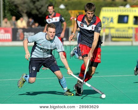 BARCELONA - JAN 7: David Watkins(L) of Monkstown HC vies with Alex Casasayas(R) of RC Polo during a King's Trophy match at the RC de Polo pitch on January 7, 2012 in Barcelona, Spain
