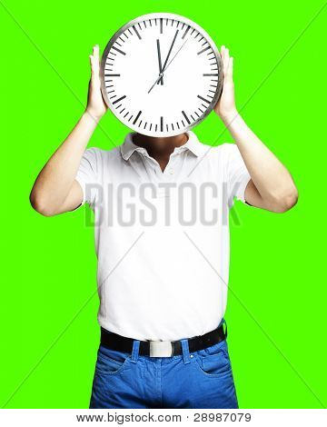 portrait of man holding clock against a removable chroma key background