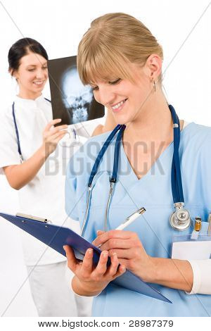 Medical team doctor young nurse female smiling look head x-ray