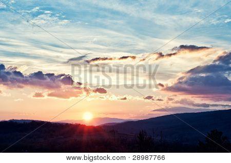 sunrise over black forest mist