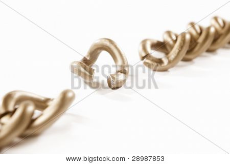 unlinked part of the chain, isolated against white background. small depth of field