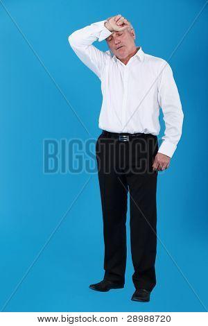 A mature businessman sweating.