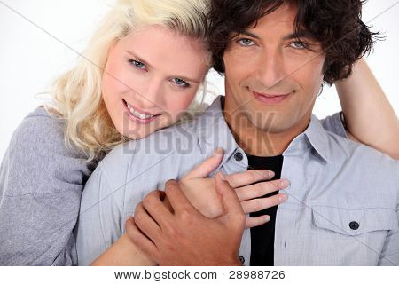 couple embracing and holding ands