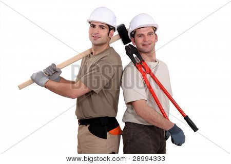 Construction worker holding heavy-duty tools