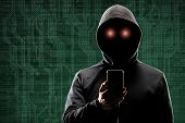 Computer hacker in mask and hoodie over abstract binary background. Obscured dark face. Data thief,  poster