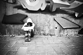 foto of rap-girl  - Suffering young girl on urban scenery - JPG