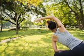 Healthy Young Asian Runner Woman Warm Up The Body Stretching Before Exercise And Yoga Near Lake At P poster