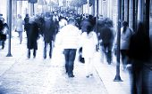 stock photo of street-walker  - Blurred people in the middle of the street - JPG