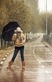 image of rainy day  - Happy young blond woman in a rainy day - JPG