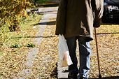 Old Man With Cane On The Walk/ Old Man Walking Down The Street With Walking Stick/ Lonely Walk Throu poster