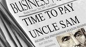 Time To Pay Uncle Sam - Newspaper headlines documenting the beginning of Tax Season. Closeup of Linc