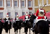 Horse guards in front each others.