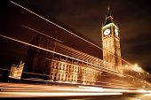 Night scene with Big Ben behind light beams