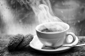 Fresh Brewed Coffee In White Cup Or Mug On Windowsill. Wet Glass Window And Cup Of Hot Caffeine Beve poster