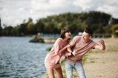 Crazy Young Couple Emotionally Having Fun, Kissing And Hugging Outdoors. Love And Tenderness, Romanc poster