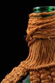 stock photo of macrame  - Wine bottle with macrame covering close up - JPG
