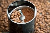 Coffee Grinder With Coffee Beans Isolated. In One Half Of Coffee Grinder Are Whole Grains Of Coffee, poster