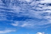 Beautiful White Fluffy Clouds On A Deep Blue Sky poster