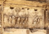 stock photo of menorah  - this wall relief on the arch of titus reveals roman soldiers carrying spoils from the destruction of the temple of jerusalem in 70 a - JPG