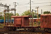 A Rusty Coloured Indian Goods Train Guards Compartment Tied With Goods Train. Goods Guards Coach. poster