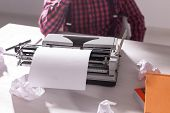 Writers Day And Technology Concept - Handsome Writer Surrounded By Scraps Of Paper Focused On Work O poster
