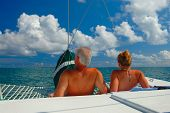 picture of sail-boats  - Couple sunbath and relax on a Sail Boat - JPG