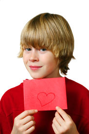 foto of valentine card  - Young boy holds up an envelope with a heart drawn it - JPG