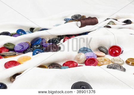 Clothing Buttons On White Linen Clothe