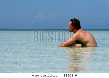 Man Sitting In Water