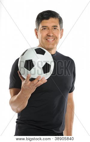 Portrait of mature Hispanic man holding soccer ball isolated over white background