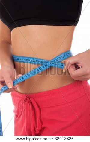 Young woman measuring perfect shape of her body