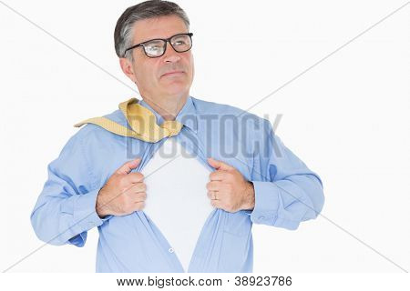 Serious man with glasses is pulling his shirt with his hands like a superhero