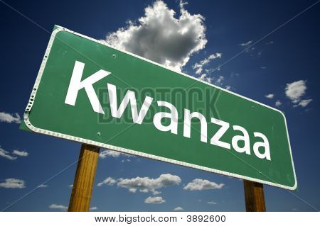 Kwanzaa Road Sign With Dramatic Clouds