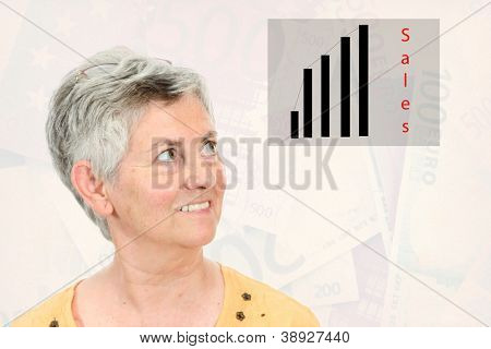 happy Mature businesswoman looking for a business chart, euros background