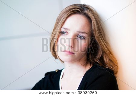 Depressed, sad woman in the living room