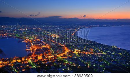The dawn sky over the reknown view of Hakodate, Japan. The city was the first in Japan to open its ports to trade in 1854.
