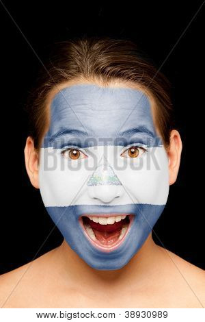 portrait of girl with nicaraguan flag painted on her face