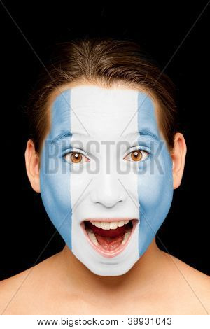 portrait of girl with guatemalan flag painted on her face