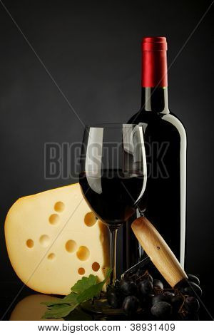 red wine and cheese on black