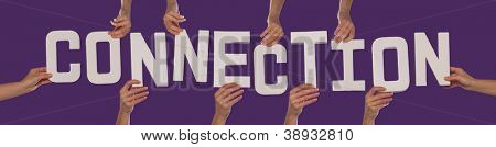 White alphabet lettering spelling CONNECTION held up over a purple studio background by outstreched female hands