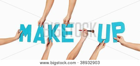 Turquoise blue alphabet lettering spelling MAKE-UP witha cosmetic brush forming the hyphen held up over an isolated white background by outstretched female hands