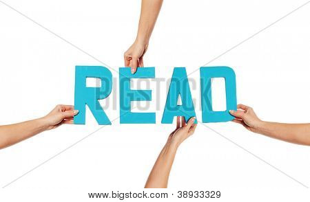 Female hands holding text word for READ in turquoise blue capital letters isolated on a white studio background