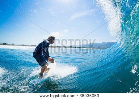 Surfer Riding Large Blue Ocean Wave
