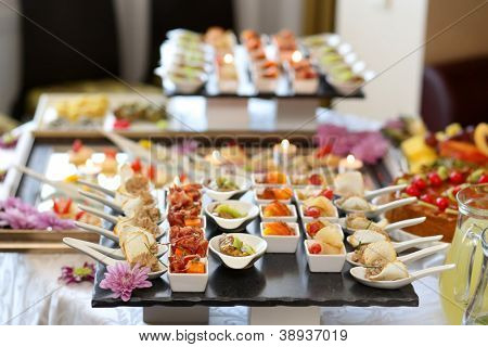 Luxury food and drinks on wedding table. Shallow DOF