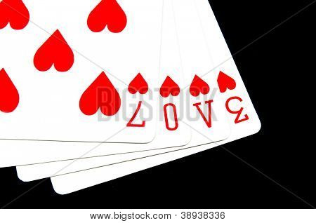 word love written with heart pips playing cards