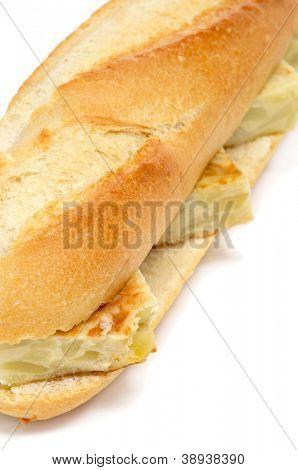 spanish tortilla de patatas sandwich on a white background