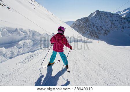 Skiing, winter, kid - skier on ski run, girl skiing downhill