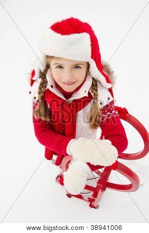Sledding, winter fun, snow, kid sledding at Christmas time