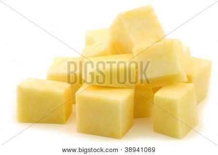 freshly cut turnip blocks (brassica rapa rapa) on a white background