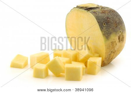 fresh turnip(brassica rapa rapa) and some cut blocks on a white background